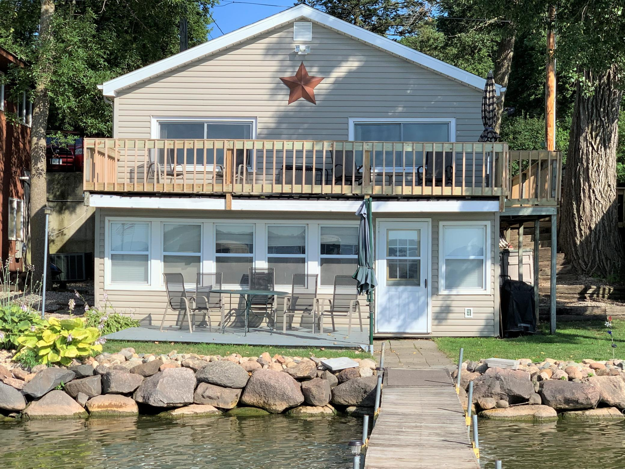 Lakefront year around furnished cabin with vinyl siding includes dock and materials. 40 feet of lake frontage. Close to State Park beach. Updated deck railings. Most windows have been updated, new roof shingles in 2019. Great deck with awesome lake view. Sunsets are spectacular and great view of 4th of July fireworks from upper and lower decks. Affordable lakefront cabin! Start making those family memories today!