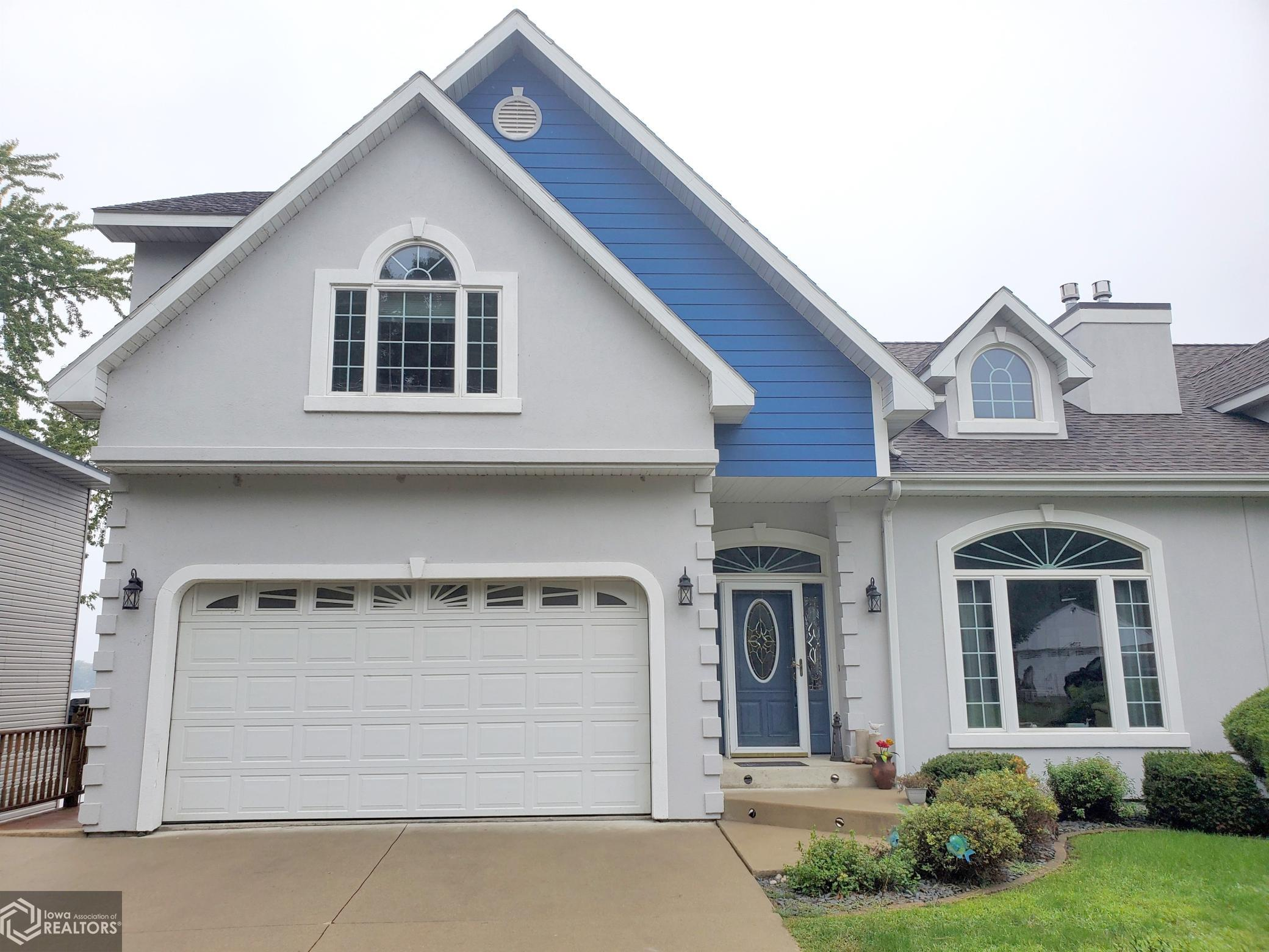 This beautiful lake townhome offers 50 feet of Lake Front, a private dock, and three full levels to accommodate the whole family. 5 bedrm. 3 1/2 baths, fireplace, dock with boat lift. Currently used as a weekly summer AirBnB. Could easily be expanded to accommodate off-season rentals as well. Just one block north of state park beach.