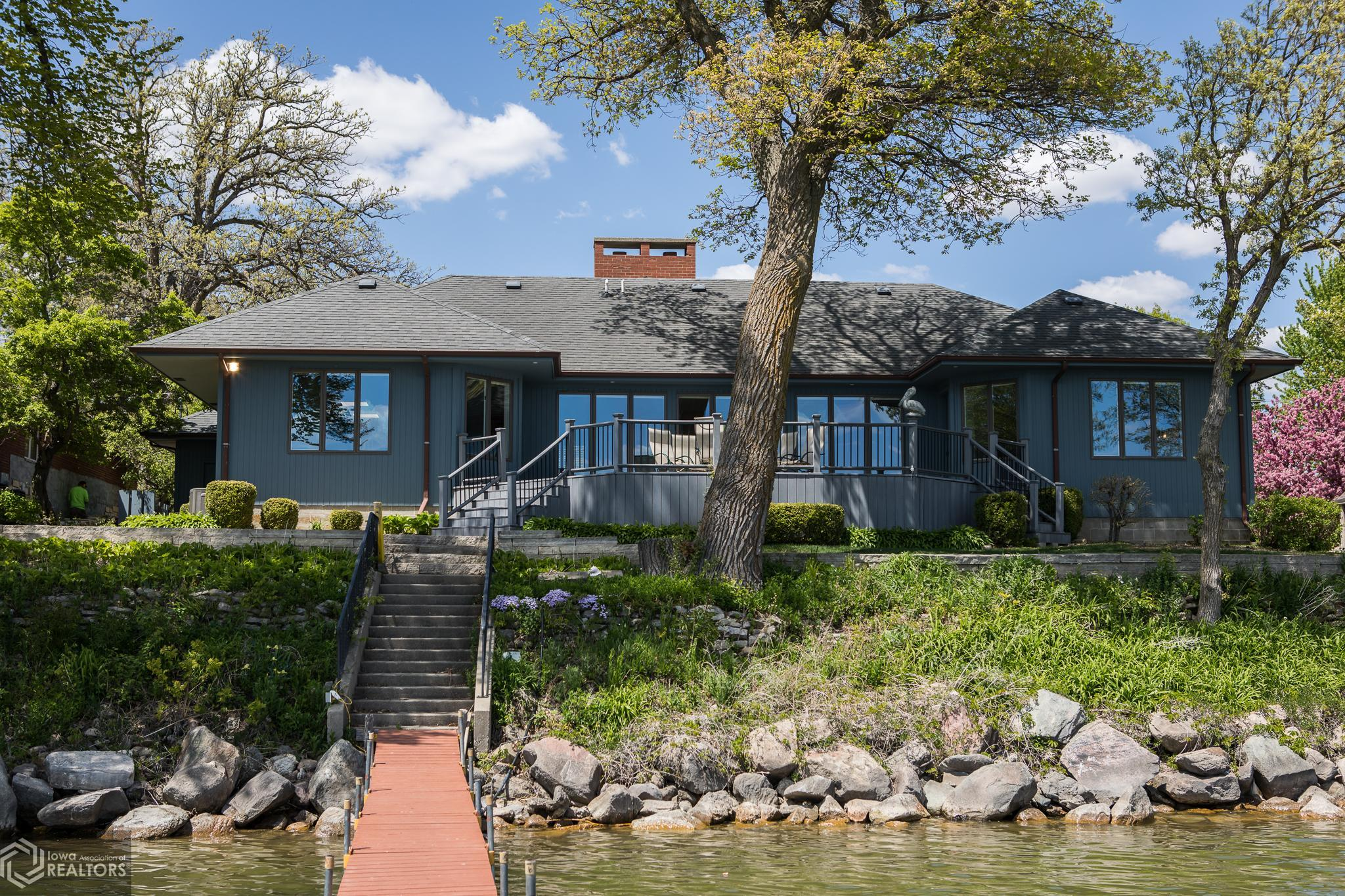 Rarely found lakefront home with 100 ft of lakeshore, attached double garage and sizeable yard! Three bedroom, 2 1/2 bath home with room for everyone. Large master suite with panoramic lake view. Large kitchen and dining with lake view. This one won't last long! Call your agent today to take a look!