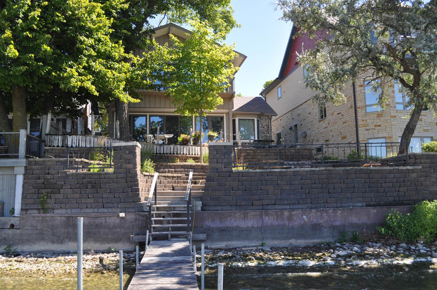 Gorgeous lake front property close to downtown Clear Lake. Spend your summers within walking distance to concerts in City Park, making memories at city beach and letting the kids play at the new splash pad! This location is hard to beat and it features some of the best sunsets Clear Lake has to offer. Many recent updates in this 5 bedroom home include solid surface countertops and beautiful quality cabinetry. The main level is an open floor plan with a large living room and an entire wall of windows overlooking the back patio and lake. Call your favorite Realtor if you are interested in touring this property.